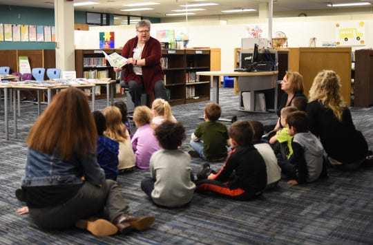 Melanie Baker, Director of Lansing Reading is Fundamental, reads to pre-kindergartners Tuesday, Oct. 15, 2019, at Riddle Elementary School in Lansing.