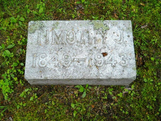 Marker for Capt. Timothy J. Kelley in Manitowoc's Evergreen Cemetery. Kelley documented changes in maritime history in more than 100 volumes of diaries, which were later donated to the Wisconsin Maritime Museum.