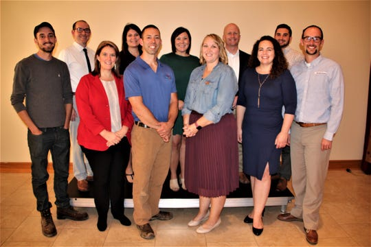 Marion County's Dynamic Dozen Under Age 40 features, front row from left, Alex Sheridan, Amber Wertman, Jason Kirkman, Maggie Breeding, Kate Fisher, and Luke Henry; back row from left, Daniel Bradshaw, Kristy Taylor, Leslie Schneider, Todd Schneider, and Robert Morris. They were honored at the Rotary Club of Marion meeting on Tuesday. Maria Williams Barnes was not  able to attend.