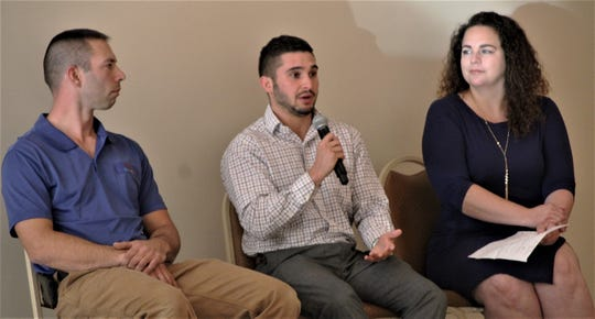 Robert Morris, center, of the Marion County Regional Planning Commission addresses Rotary Club of Marion members during the group's luncheon on Tuesday. He is flanked by fellow members of Marion County's Dynamic Dozen Under Age 40 Jason Kirkman, left, and Kate Fisher, right.