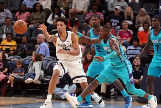 Memphis Grizzlies' Brandon Clarke (15) passes the ball as Charlotte Hornets' Terry Rozier lll (3) closes in in the first half of a preseason NBA basketball game Monday, Oct. 14, 2019, in Memphis, Tenn.