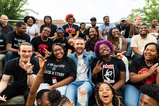 Millington native Justin Timberlake posing with students outside the Stax Music Academy.