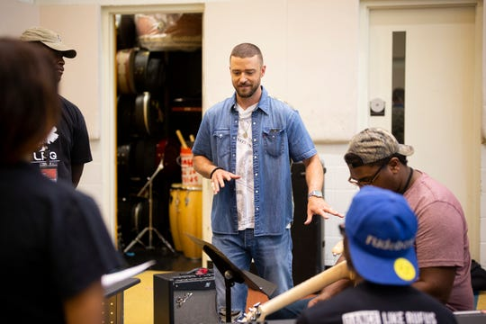 Justin Timberlake working with students at the Stax Music Academy. Timberlake and Levi's helped fund The Song Lab at Stax.