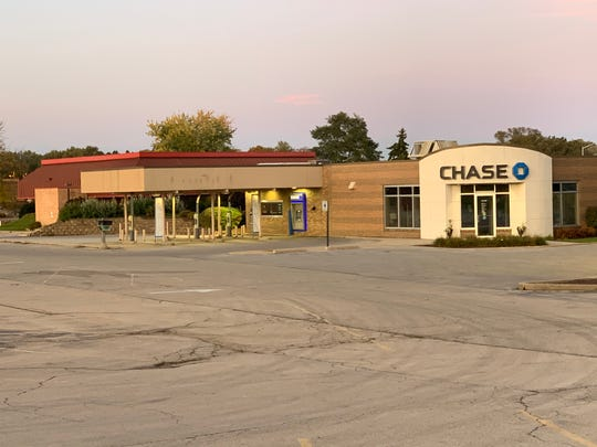 Chase Bank remains as the only other tenant other than Sentry Foods inside the older portion of the Fox Run shopping center at Sunset Drive and St. Paul Avenue in Waukesha. Pictured behind the bank is the former Denny's restaurant, which has also stood vacant for several years.