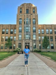 Amaii Collins stands outside her school, Rufus King International High School, where she participates in Link Crew.