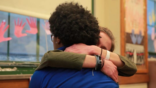 Amaii Collins and Hannah Olenchek embrace at Rufus King International High School.