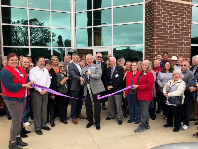 The Chamber Ambassadors cut the ribbon at the open house for Hospice of the Ozarks new Administrative/Warehouse Building located at 811 Burnett Drive in Mountain Home. Hospice of the Ozarks has been serving residents of Baxter and Marion counties since 1979. Hospice of the Ozarks core purpose is to improve the quality of life for individuals and their families in the last phases of an incurable illness. They are available 24 hours a day, 7 days a week, from physicians, nurses, social workers, hospice aides, volunteers and chaplains. For more information on hospice care contact Hospice of the Ozarks at  (870) 508-1771.