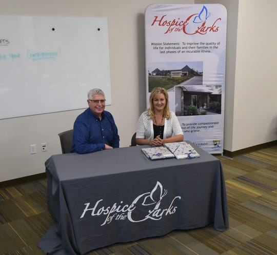 Hospice of the Ozarks Executive Director Greg Wood (left) and Outreach and Development Coordinator Elaine Essary sit inside the Rhoades Family and FSIS Investment Room inside the hospice's administrative building on Oct. 10. The large room can be used for staff training of for community events.