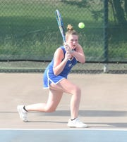 Mountain Home's Meagan Beck returns a shot during a match earlier this season.