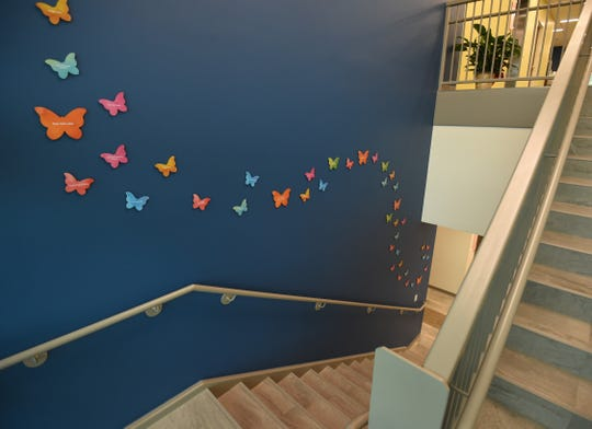 Butterflies bearing the names of Hospice of the Ozarks donors can be seen in the main stairwell of the hospice's new administrative building. Plans call for the butterflies to circle the stairwell and eventually spread throughout the hallways of the building.