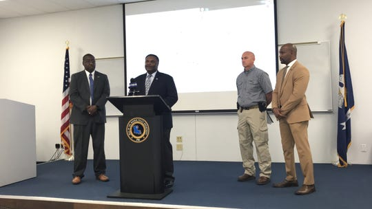Police Chief Eugene Ellis, Mayor Jamie Mayo, Ltn. Triche Passman and Public Information Officer Reginald Brown at a Tuesday press conference.