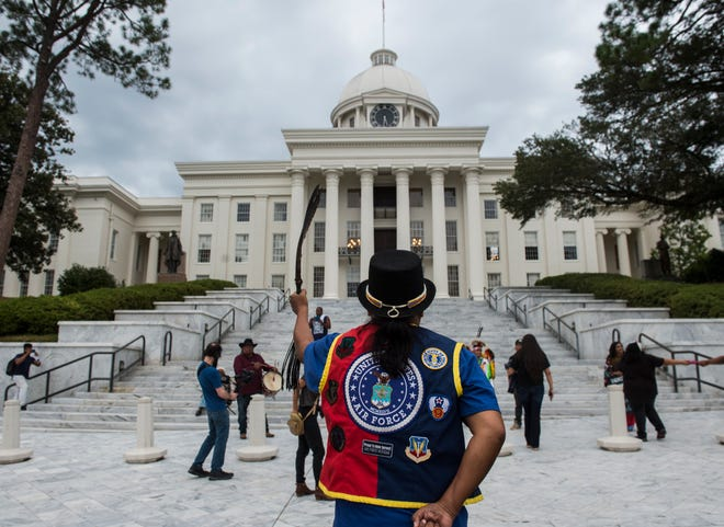 William 'Dan' Isaac approaches the steps of the capitol as Alabama Indigenous Coalition members and supporters march on Dexter Ave. in Montgomery, Ala., on Monday, Oct. 14, 2019. Alabama Indigenous Coalition wants the city to change Columbus Day to Indigenous Peoples Day.