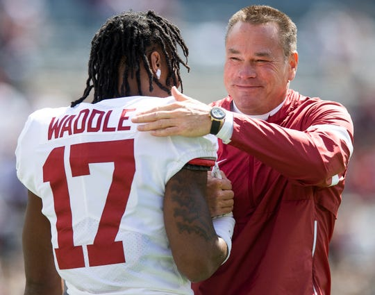 Alabama offensive analyst Butch Jones with wide receiver Jaylen Waddle (17) before the Texas A&M game at Kyle Field in College Station, Texas on Saturday October 12, 2019.