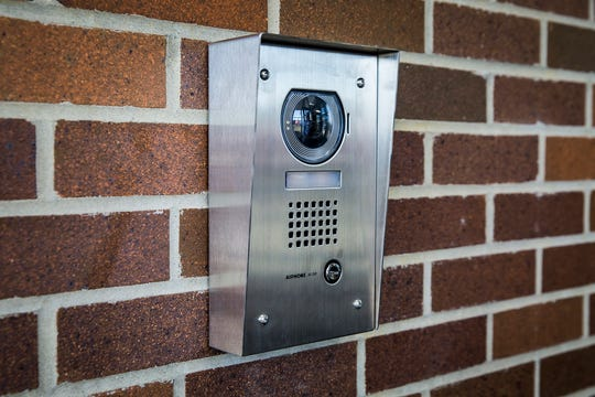 A security camera is positioned at the newly constructed entrance to Delta High School.
