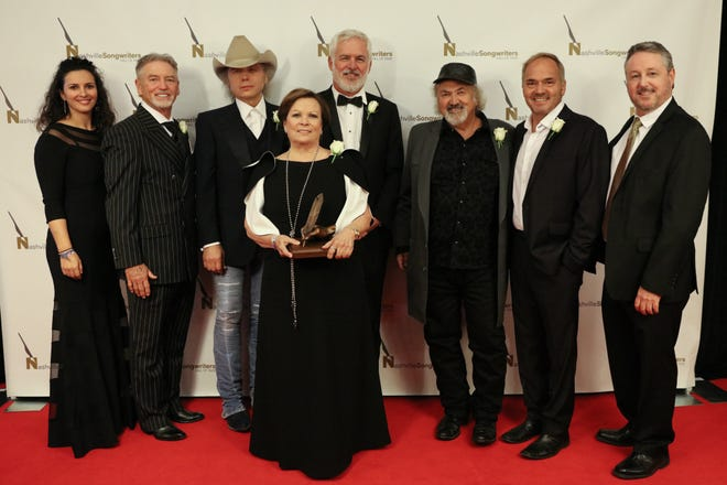 From Left to right Nashville Songwriters Hall of Fame Board chair Sarah Cates; inductees Larry Gatlin, Dwight Yoakam, Sharon Vaughn, Rivers Rutherford, Kostas and Marcus Hummon and  executive director Mark Ford.