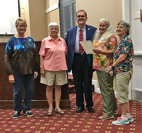 FCE Week Proclamation at City Commissioner meeting. Left to right: Carol McClure, leader of Fairview FCE night group; Kathy Tarolli, FCE member; John Blade, mayor of Fairview; Sarah Lauricella, Co-President Fairview day group; Mae Alt, secretary Fairview FCE day group.