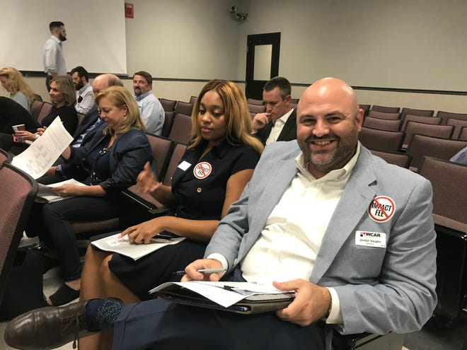 Williamson County Association of Realtors president-elect Jordan Vaughn (right) spoke against a resolution that would implement an increase in the existing education impact fee at the Williamson County Commission meeting on Monday.