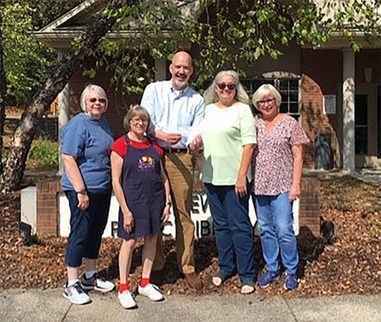 Fairview FCE 2019 donation to Fairview Public Library: left to right: Mary Alice Weber, Barbara Comer, Librarian Philip McAndrew, Sarah Lauricella, and Debbie McNamara.