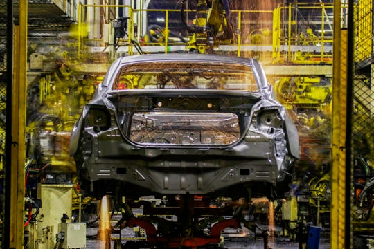 Body assembly line at Nissan plant.