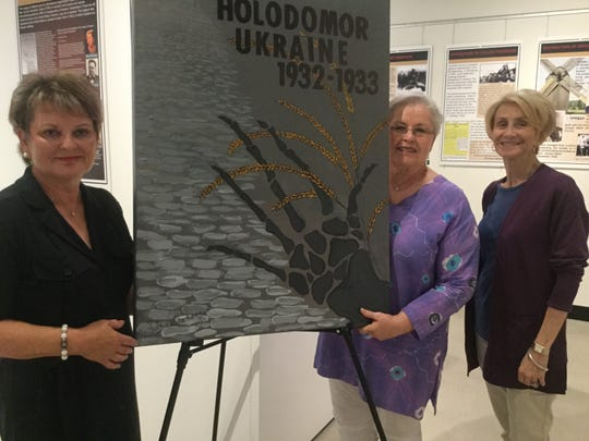 Left, Natalie Santarsiero, Luba Drahosz and Halyna Traversa of the Ukrainian National Womens League of America with the Holodomor poster