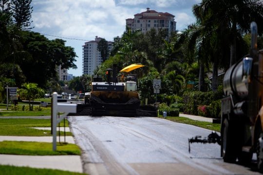 Road crews work on a paving and resurfacing project along Vanderbilt Drive between 101st and 106th Avenues North, Monday, Oct. 14, 2019, in Naples Park. After delays, crews are working to wrap up a water pipes and utilities project along Vanderbilt Drive from Vanderbilt Beach Road to 111th Avenue North.
