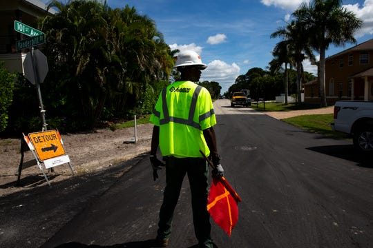 Marvin Cherry keeps traffic moving, Monday, Oct. 14, 2019, along 101st Avenue North and Vanderbilt Drive in Naples Park.