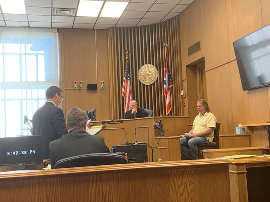 Defense attorney Robert Calesaric questions witness Duane Priest during the trial of Harry P. Johns on Tuesday, Oct. 15, 2019. Johns is accused in the crushing death of Gary Conard, 59, of Utica.