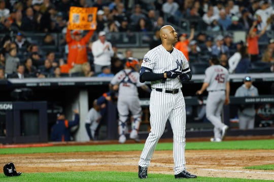 New York Yankees' Aaron Hicks reacts after striking out against the Houston Astros during the sixth inning in Game 3 of baseball's American League Championship Series Tuesday, Oct. 15, 2019, in New York.