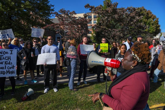 Montclair teachers and staff protest problems with their paychecks, including a glitch that resulted in no paycheck at all for those enrolled in direct deposit in front of the Montclair Public Schools Administrative building on Tuesday, October 15, 2019. (right) Montclair Education Association President Petal Robertson.