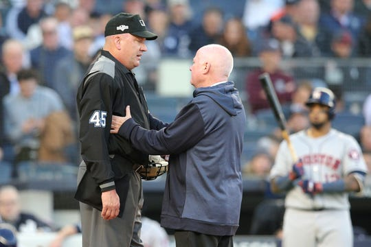 Oct 15, 2019; Bronx, NY, USA; MLB home plate umpire Jeff Nelson is checked by New York Yankees trainer Steve Donahue after a foul ball during the fourth inning in game three of the 2019 ALCS playoff baseball series against the Houston Astros at Yankee Stadium.