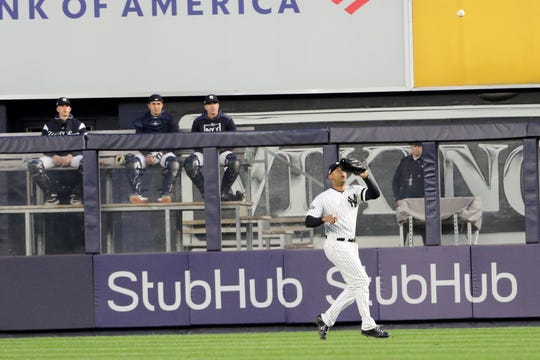 Aaron Hicks, of the Yankees, catches a long fly ball, for an Astros out. Tuesday, October 15, 2019