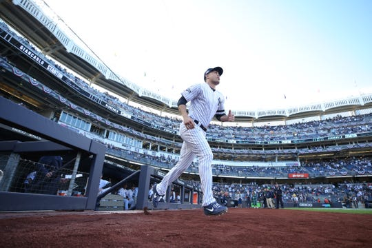 Oct 15, 2019; Bronx, NY, USA; New York Yankees left fielder Giancarlo Stanton (27) runs on to the field during player introductions before game three of the 2019 ALCS playoff baseball series against the Houston Astros at Yankee Stadium.