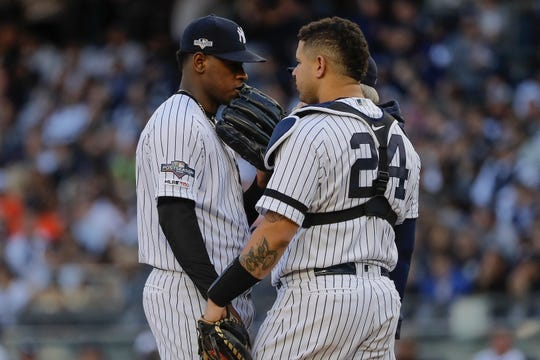 New York Yankees starting pitcher Luis Severino talks with catcher Gary Sanchez (24) during the first inning of Game 3 of baseball's American League Championship Series against the Houston Astros, Tuesday, Oct. 15, 2019, in New York.