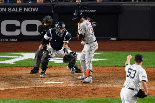 Oct 15, 2019; Bronx, NY, USA; New York Yankees catcher Gary Sanchez (24) is unable to block a wild pitch to Houston Astros first baseman Yuli Gurriel (10) by relief pitcher Zack Britton (53) during the seventh inning in game three of the 2019 ALCS playoff baseball series at Yankee Stadium.
