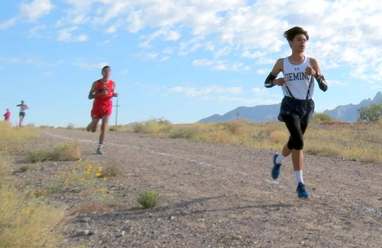 Sophomore Wildcat Esau Au (in front)  led the Deming High varsity boys with a 37th place finish in the time of 19:33 on Saturday at the Centennial Cross Country Meet in Las Cruces.