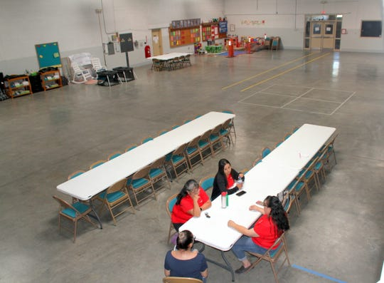 Workers at the Deming Migrant Relief Shelter take a break on Monday afternoon.