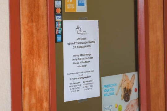 A sign noting hour changes is posted at entrance to the Las Cruces Animal Emergency Clinic is pictured in Las Cruces on Tuesday, Oct. 15, 2019.