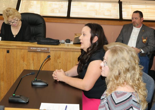 Jessica Stygar (left) and Roberta Smith of the Eddy County Finance Department explain a proposed travel plan change for county employees during an Eddy County Board of Commissioner's meeting Oct. 15 in Carlsbad.