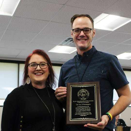 Melissa Cheffers and Paul Stewart III accept the Youth Program of the Year award on behalf of Heather McGaughey Children's Theatre, Tuesday, Oct. 15, 2019, during the Farmington City Council meeting.