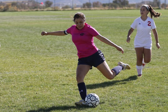 Piedra Vista's Natalie Flores passes the ball down the right side against West Mesa during Tuesday's District 2-5A girls soccer match at PVHS.