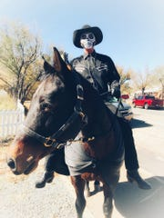 Behold the pale rider and his name was death, or maybe that's just Matt Midgett on his horse Belle at last year's celebration in Lincoln.