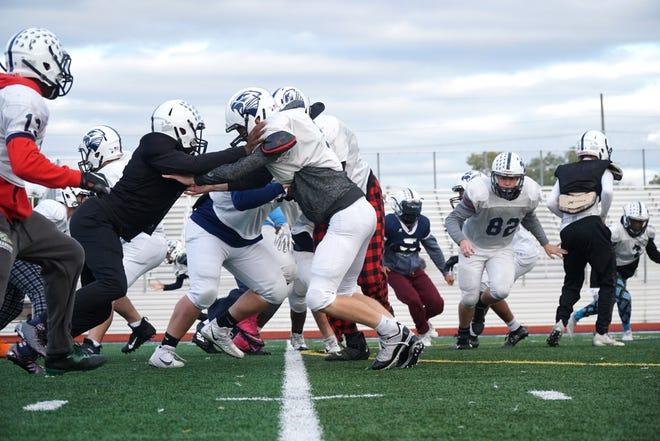 Farmington High runs a play during practice on Oct. 14.