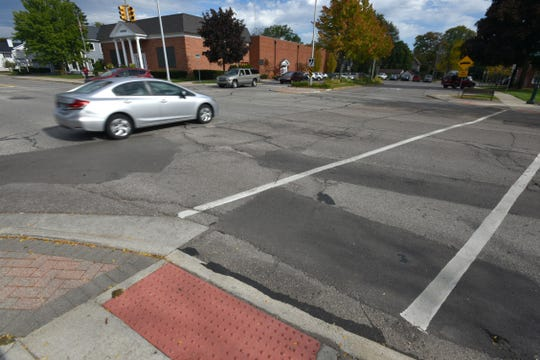 A lot of patch jobs on the road surface near Plymouth's Main and Church intersections.