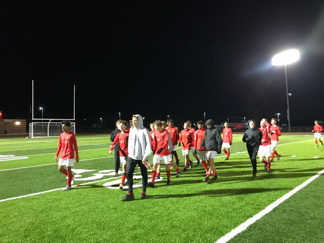 The Canton boys soccer team walks off the field after defeating Livonia Churchill 6-0 in the district semifinal.