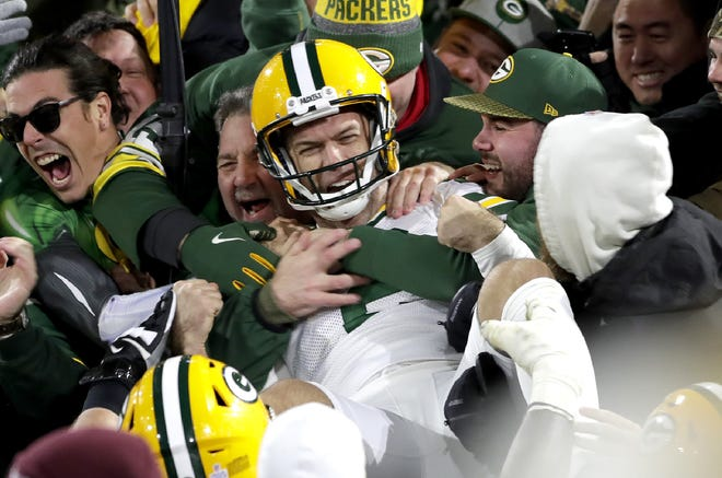 Green Bay Packers kicker Mason Crosby (2) celebrates with a Lambeau Leap after kicking the game winning field goal against the Detroit Lions during their football game Monday October 14, 2019, at Lambeau Field in Green Bay, Wis. The packers defeated the Lions 23 to 22.