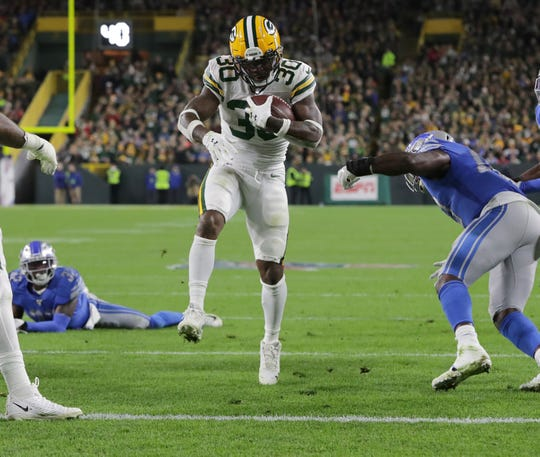 Green Bay Packers running back Jamaal Williams (30) scores on five yard reception during the second quarter of their game against the Detroit Lions Monday, October 14, 2019 at Lambeau Field in Green Bay, Wis.