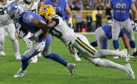 Detroit Lions wide receiver Kenny Golladay (19) is stopped short of a touchdown by Green Bay Packers cornerback Kevin King (20) during the first quarter of their game Monday, October 14, 2019 at Lambeau Field in Green Bay, Wis.