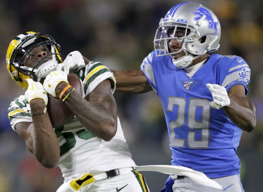 Green Bay Packers wide receiver Marquez Valdes-Scantling (83) makes a reception under the defense of Detroit Lions cornerback Rashaan Melvin (29)  during their football game Monday October 14, 2019, at Lambeau Field in Green Bay, Wis. The packers defeated the Lions 23 to 22.