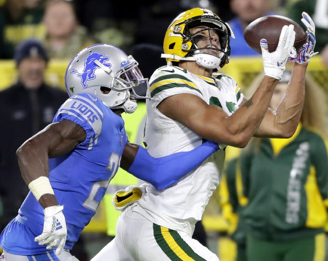 Green Bay Packers wide receiver Allen Lazard (13) catches a fourth quarter touchdown pass over the defense of Detroit Lions cornerback Justin Coleman (27) during their football game Monday October 14, 2019, at Lambeau Field in Green Bay, Wis.