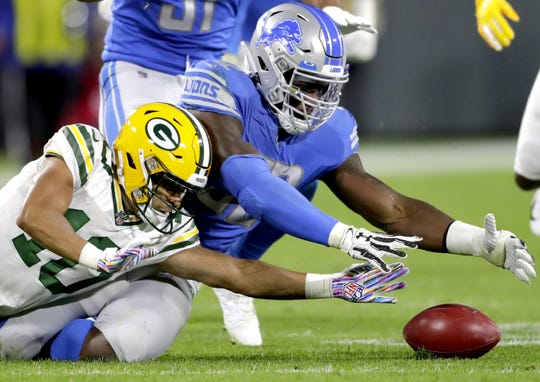 Green Bay Packers wide receiver Darrius Shepherd (10) and Detroit Lions defensive back Dee Virgin (30) dive for the ball after Shepherd fumbled a punt return during their football game Monday October 14, 2019, at Lambeau Field in Green Bay, Wis. The packers defeated the Lions 23 to 22.